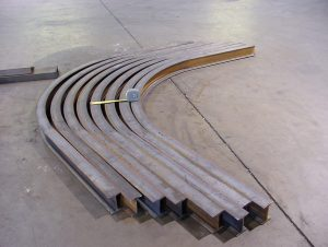 Angled rolled beam